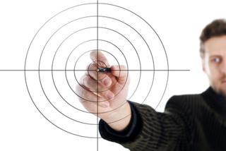Man aims a target